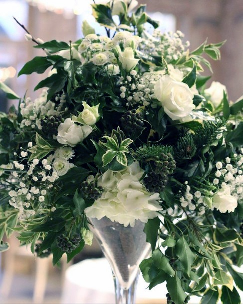 Pure White Christmas Flowers And Greens Wedding