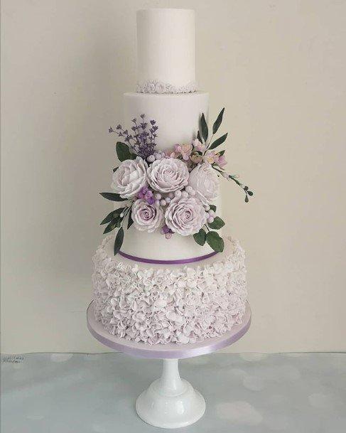 Pure White Wedding Cake With Purple Flowers