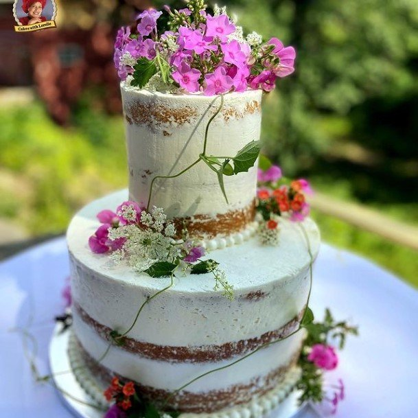 Purple Flowers On Country Wedding Cakes