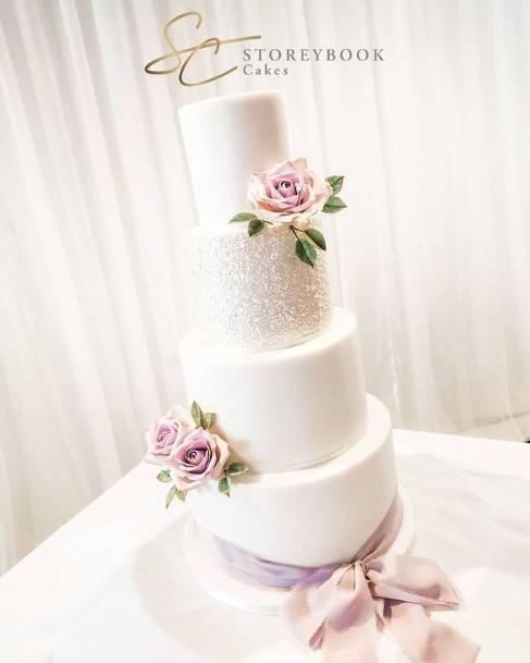 Purple Flowers On Pure White Beautiful Wedding Cakes