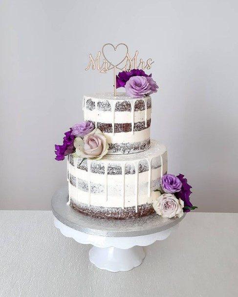 Purple Flowers On White Wedding Cake