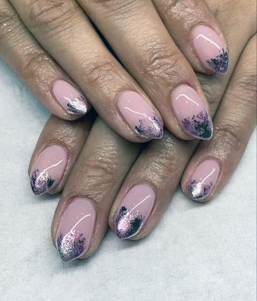 Razor Ended Silver Nails With Light Pink Polish
