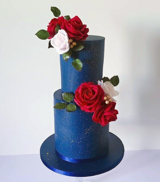 Red And White Roses On Blue Wedding Cake