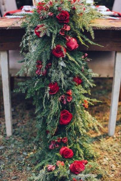 Red Roses And Greens Christmas Wedding Flowers