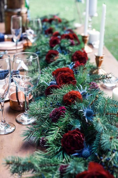 Rich Greens And Red Roses Christmas Wedding Flowers