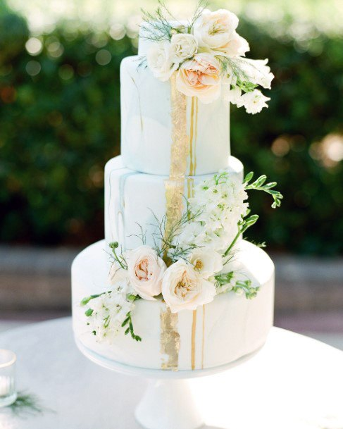 Rich White Wedding Cake With June Flowers