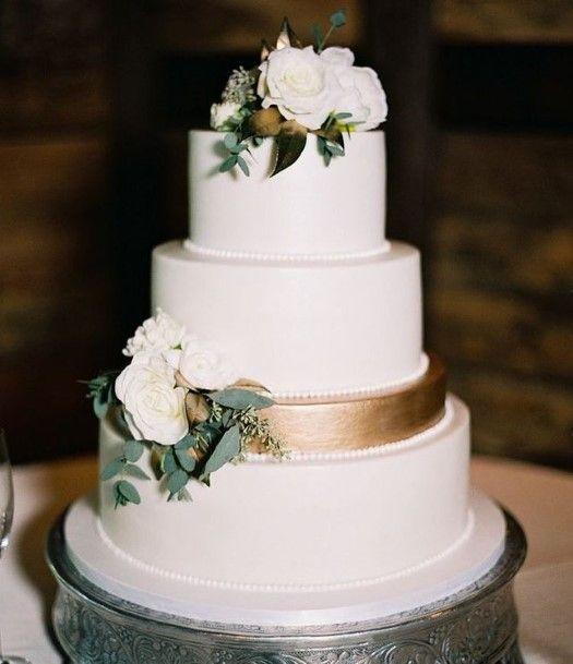 Rose Gold Band On White Wedding Cake