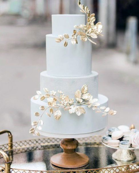 Rose Gold Flower Ornaments On Elegant Wedding Cake Women