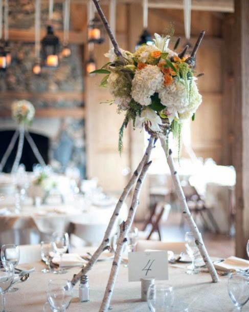 Rustic Wedding Decor With Twigs And Flowers