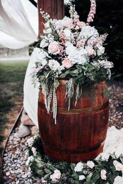 Rustic Wedding Flowers On Barrel