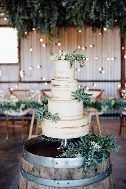 Rustic Wedding Ideas Greenery On Cake And Wooden Wine Barrel Cake Table