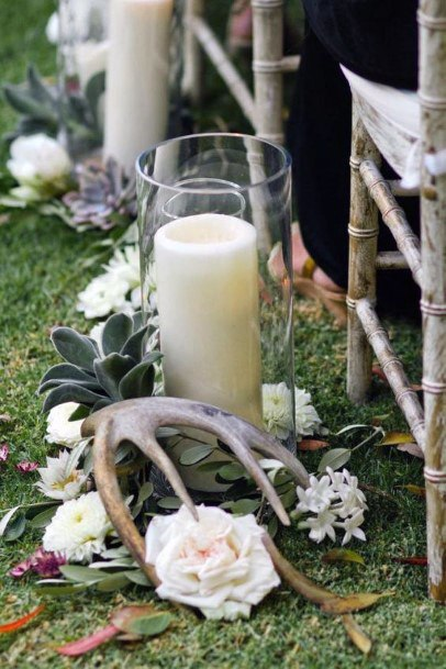 Rustic Wedding Ideas White Roses White Candles And Antler Aisle Decorations