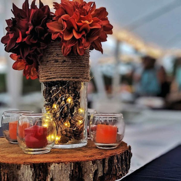 Rusty Orange And Burgudny Centerpieces On Wood Slab Rustic Fall Wedding Ideas