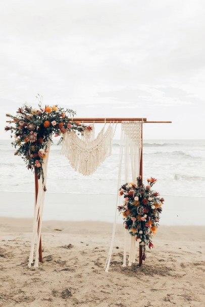 Sandy Beach Wedding Arch With Boho Flowers
