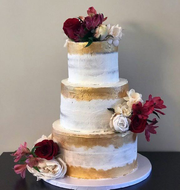 Scrumptious Gold And White Wedding Cake