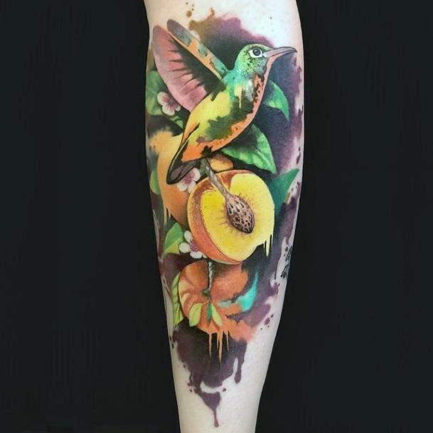 Seeded Fruit And Hummingbird Tattoo For Women