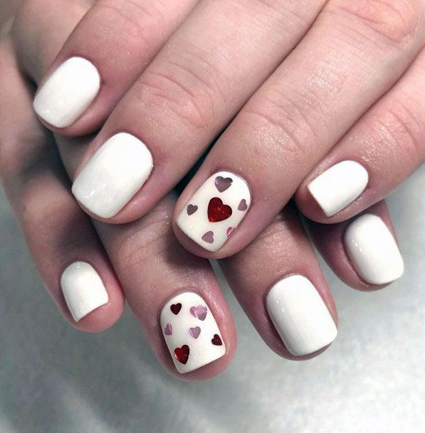 Shiny Red Hearts On White Gel Nails