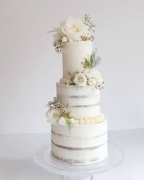 Silver Bands On Beautiful White Wedding Cake With Roses