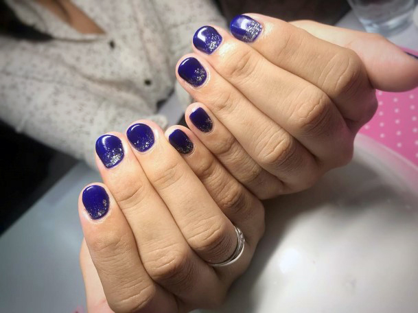 Silver Sparkles On Dark Blue Cat Eye Nails