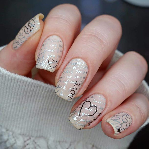 Silvered Nails With Romantic Black Designs Women