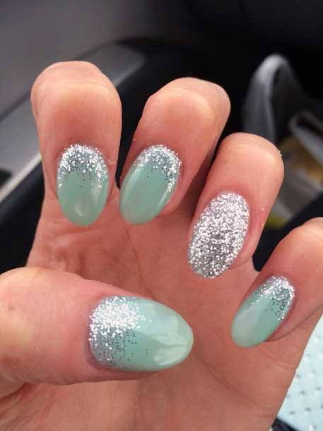 Silvery Glitters On Light Green Nail