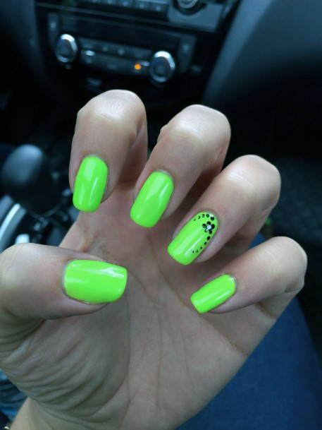 Simple Black Floral Art On Neon Green Nails