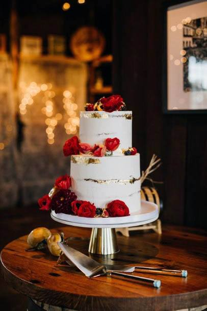 Simple Wedding Cake With Red Flowers