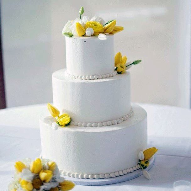Simple Yellow Flowers On White Cake