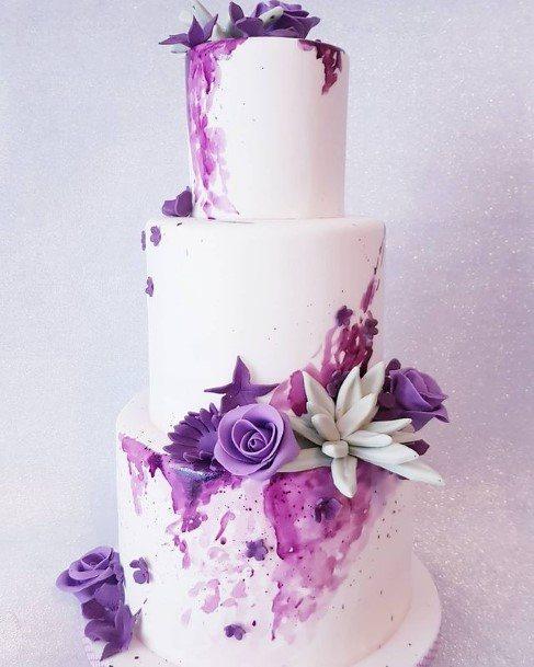 Smooth White Wedding Cake With Purple Flowers