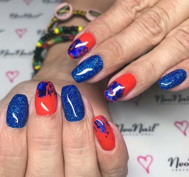 Sparkly Navy Blue And Orange Nails For Women