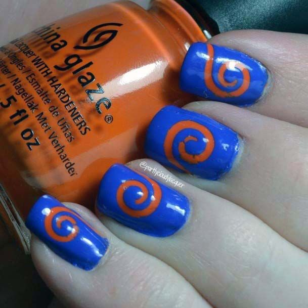 Spiral Orange Design On Blue Nails For Women