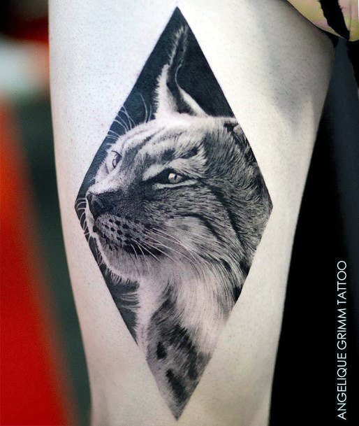 Squinting Eyed Cat In Diamond Frame Tattoo For Women