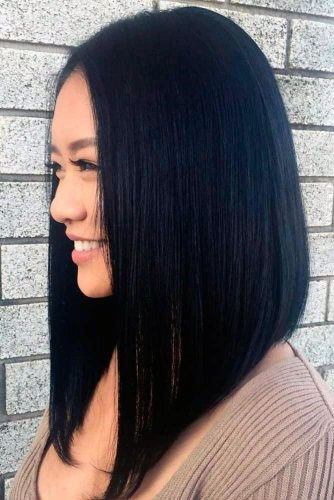Straight Black Symmetrical Cut Hairstyle For Women