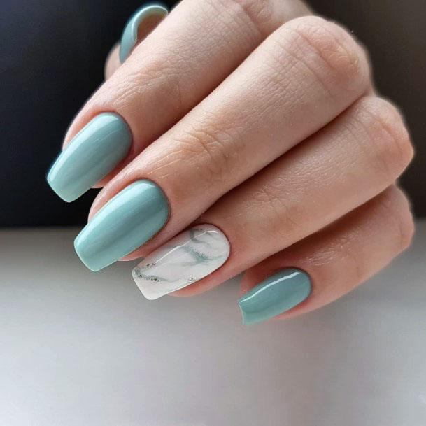 Subdued Mint Nails With White Marble Accent For Women