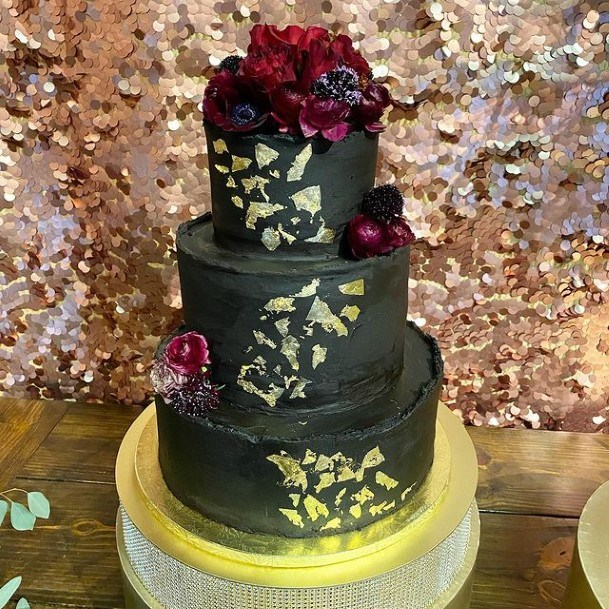 Sumptuous Black Wedding Cake With Gold Art