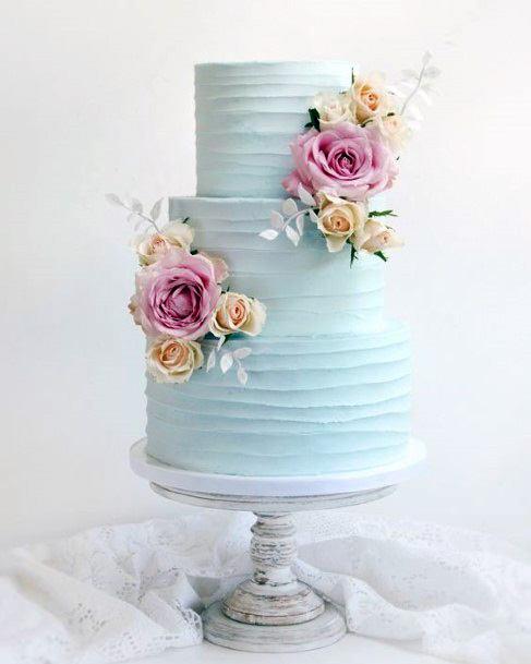 Swirls Of Light Blue Cream Wedding Cake