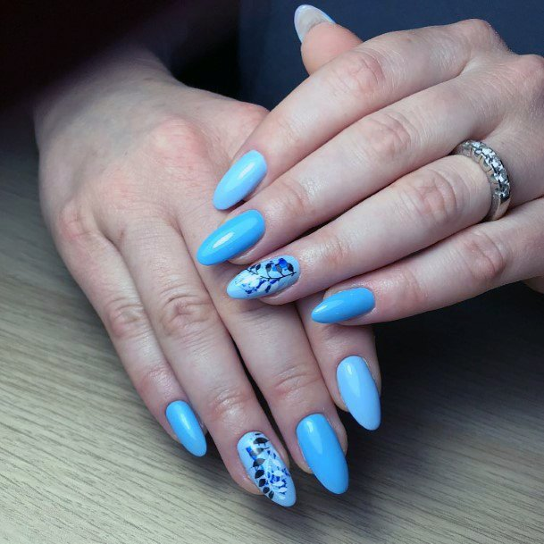 Teal Blue Shellac Nails With Black Leaf Print For Women