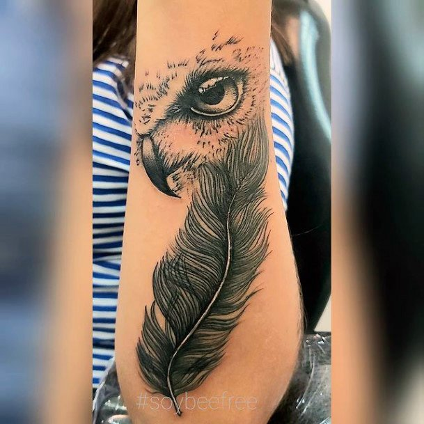 Thick Grey Feather And Eye Ball Tattoo Women