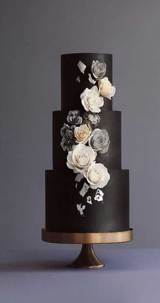 Three Tiered Weddng Cake With White Roses