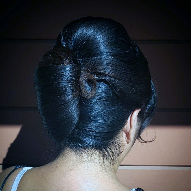 Tight French Twist And A Side Curl And Curled Bangs For Women And Girls