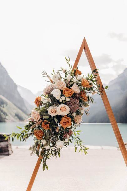 Triangular Arch With August Wedding Flowers