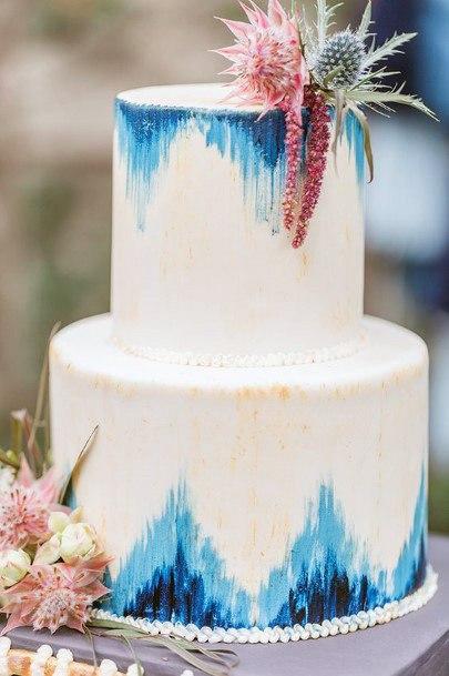 Triangular Blue Art White Wedding Cake