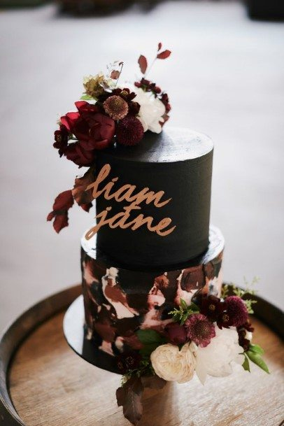 Two Tiered Black Wedding Cake With Flowers