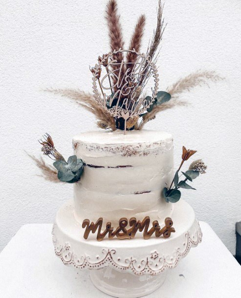 Ultra Bohemian Single Tiered White Cake With Dried Grass And Flowers Wedding Cake Ideas