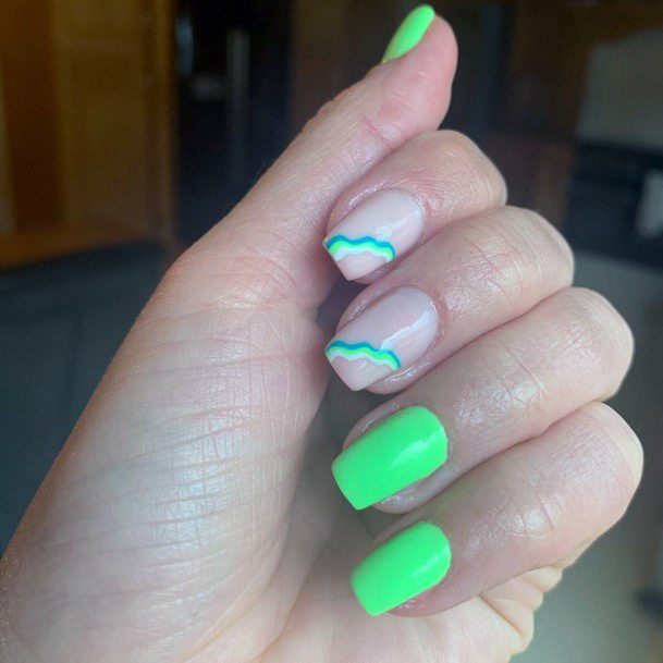Unique Art Work On Neon Green Painted Nails