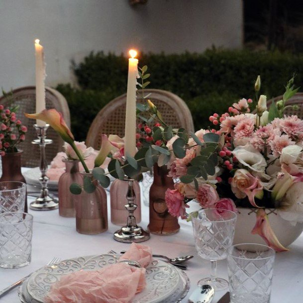 Warm Candles And Blush Roses Wedding Flowers