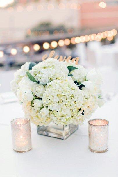 Warm Candles And Hydrangea Wedding Flowers