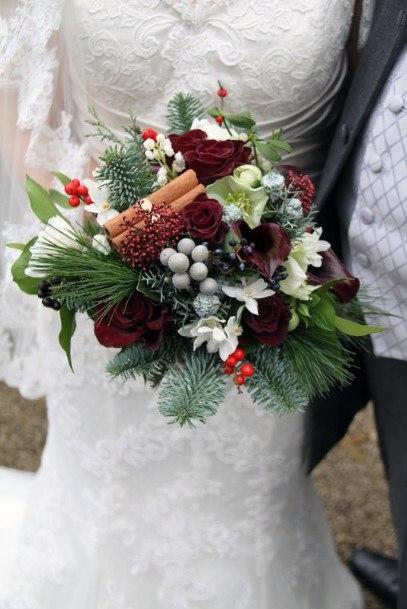 Warm Cinnamon And Greens Christmas Wedding Flowers