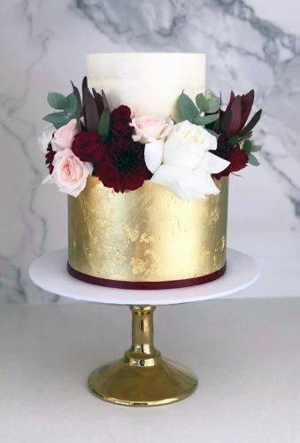 Wedding Cake Ideas Beautiful Two Toned White And Gold Cake With Burgundy And Blush Flowers