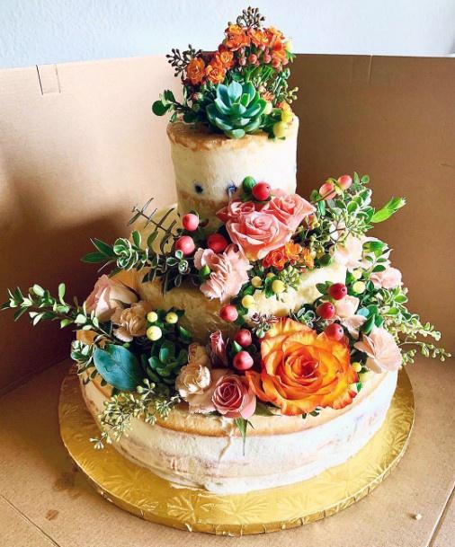 Wedding Cake Ideas Whimsical Woodland Semi Naked Cake With Lush Greenery And Abundant Florals
